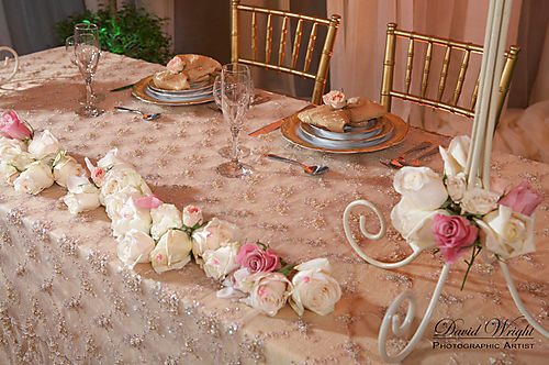 Sweetheart table with white,cream, and pink roses