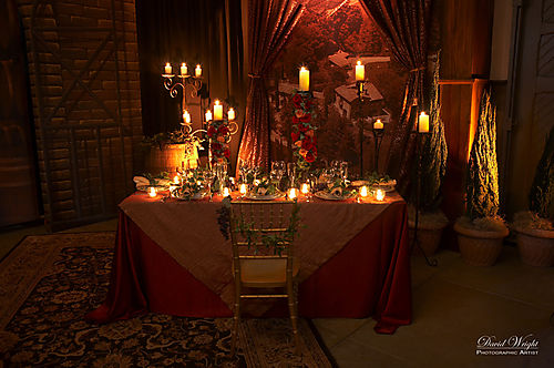 Red and orange tabletop with lots of candles