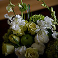 Cube centerpieces with roses, hydrangea, and dendrobium orchids