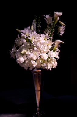white altar arrangement in white