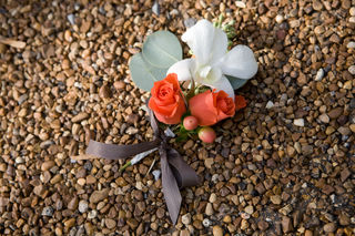orange spray rose and dendrobium orchid corsage