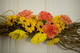 Wooden Wreaths with carnations, mums, and daisies