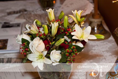 White lily, rose, and hypericum centerpieces
