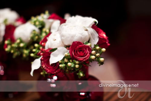 gold touched red rose and peony bouquet