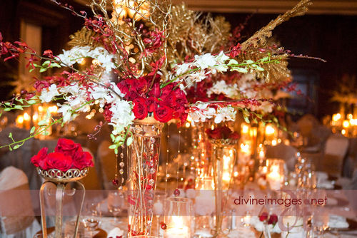 Crystals hung from the centerpieces and tall gold pedestals filled with red