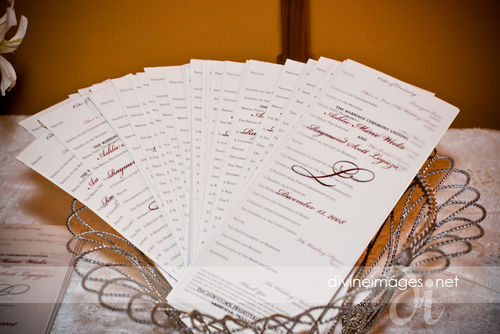 Programs printed on gold paper with vellum overlay