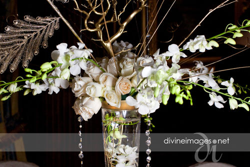 white rose and orchid centerpiece