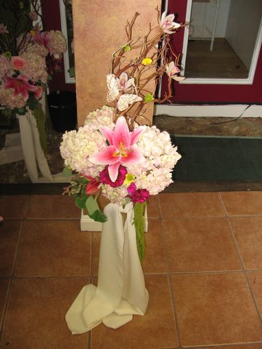 arrangement with manzanita and orchids