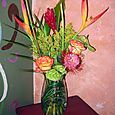 Solidago, heliconia, and rose arrangement
