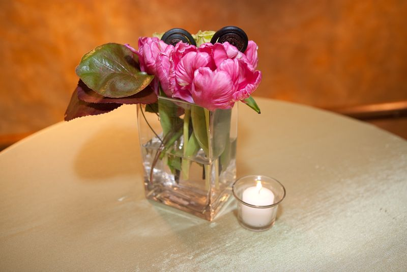 Parrot french tulips and fern curl centerpiece