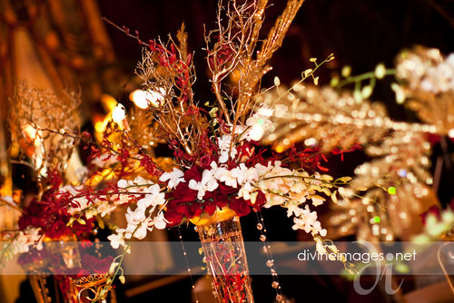 Centerpieces event design a dramatic red white gold