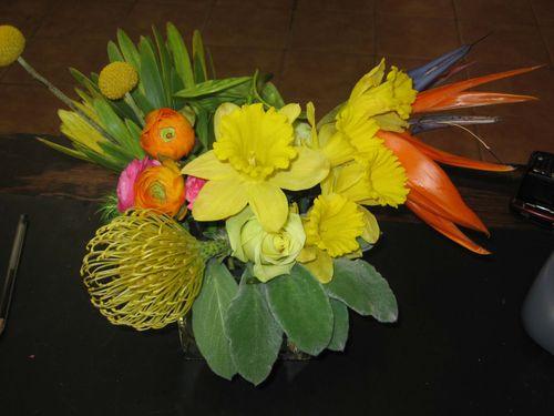 Crapsedia, rannunculus, and daffodil arrangement