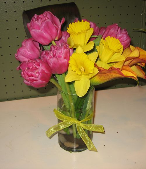 Side view of tulips, daffodil, and gerbera daisy